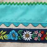 Linen bag with blue appliqué ribbo..